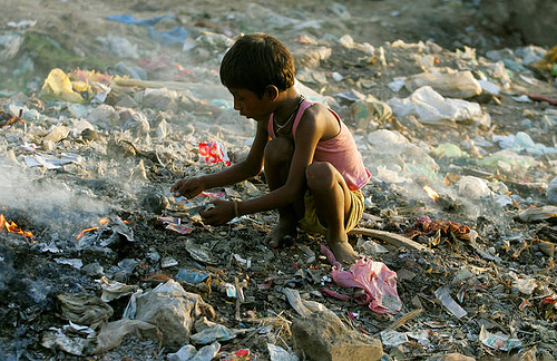 Child searches for valuables in a garbage dump in New Delhi