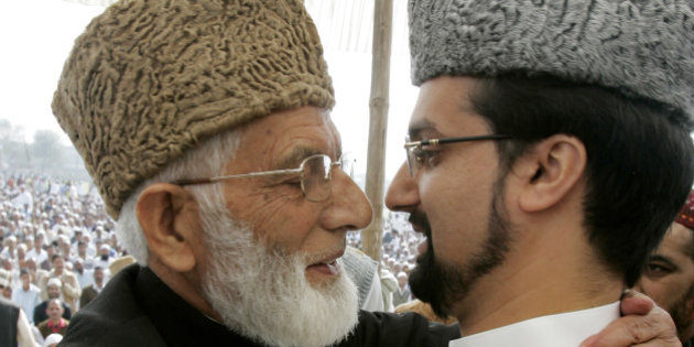 Chairmans of Kashmir's moderate faction of APHC Umar Farooq and of APHC's hardliner faction Geelani hug in Srinagar